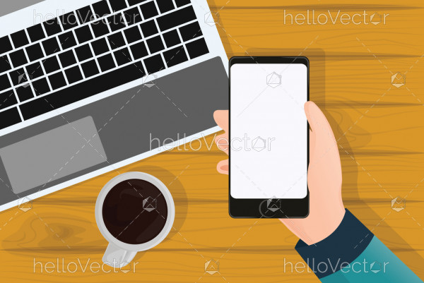 Hand holding mobile phone, Phone blank screen on table top view